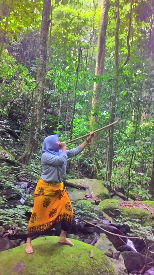 Febri, one of Tanjung Puting National Park's Best Female Guides, Hunting with a Traditional Dayak Blow Dart Gun (near Kundangan Village, Kalimantan, Borneo, Indonesia)