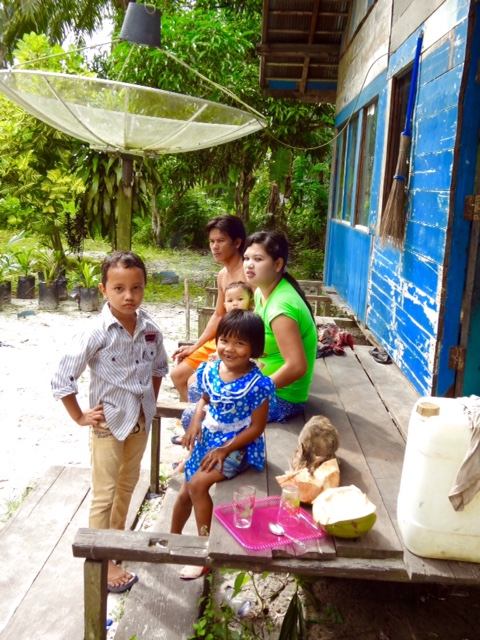 Family at the Palm Oil Village; the Father Works at the Palm Oil Plantation (Kumai, Kalimantan, Borneo, Indonesia)